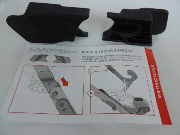 Reductor del balanceo del porta bebé Matrix Light para los chasis modelo Rider y Trider de Jané. Valido solo en las sillas con el soporte en el chasis. (circulo rojo en la foto)